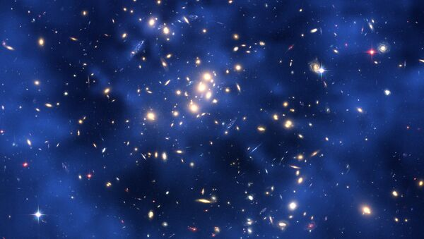 This NASA handout image received 15 May 2007 shows dark matter ring in a galaxy center - Sputnik International
