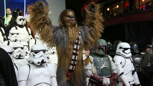 People dressed as characters from the film pose for photographers upon arrival at the European premiere of the film 'Star Wars: The Force Awakens ' in London. - Sputnik International