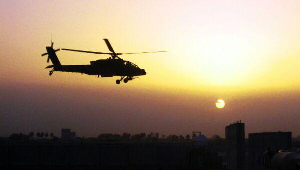 An AH-64D Apache helicopter, belonging to 1st Battalion, 4th Aviation Regiment, Attack Reconnaissance Battalion, flies over Iraq. - Sputnik International