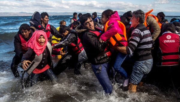 Migrants disembark safely from their frail boat in bad weather on the Greek island of Lesbos after crossing the Aegean see from Turkey, Wednesday, Oct. 28, 2015. - Sputnik International