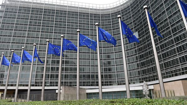 European flags flutter in front of the European Commission building as the European Commission President-elect unveils the list of the new European Commissioners during a press conference in Brussels, on September 10, 2014 - Sputnik International
