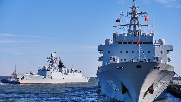 Chinese Navy replenishment ship 'Qiandaohu' (R) and multi-role frigate 'Yiyang' (L) enter the port of Gdynia in Gdynia, Poland, on October 7, 2015, marking the first-ever such visit in the NATO and EU member - Sputnik International