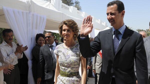 Syrian President Bashar Assad and his wife Asma Assad. (File)  - Sputnik International