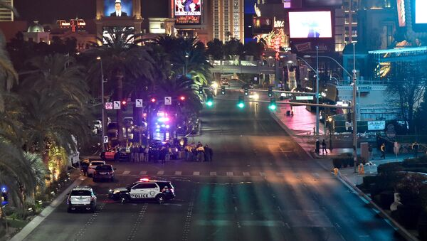 Las Vegas police investigate along the Las Vegas Strip following a traffic accident in front of the Planet Hollywood Hotel in Las Vegas, Nevada, near the hotel and casino where the Miss Universe pageant was being held, December 20, 2015 - Sputnik International