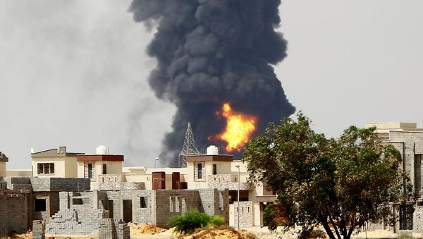 A picture taken on July 28, 2014 shows flames and smoke billowing from an oil depot where a huge blaze started following clashes around Tripoli airport, in southern Tripoli - Sputnik International