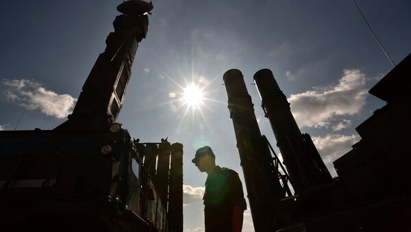 A serviceman stands near an S-300 surface-to-air missile system. (File) - Sputnik International