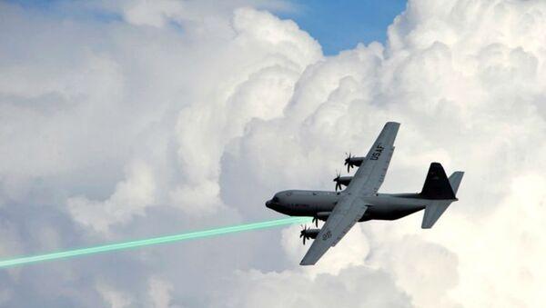 Photo illustration of an AC-130 gunship firing a laser weapon - Sputnik International