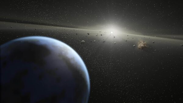 This artist's rendition released 20 April, 2005 by NASA shows a massive asteroid belt in orbit around a star the same age and size as our Sun - Sputnik International