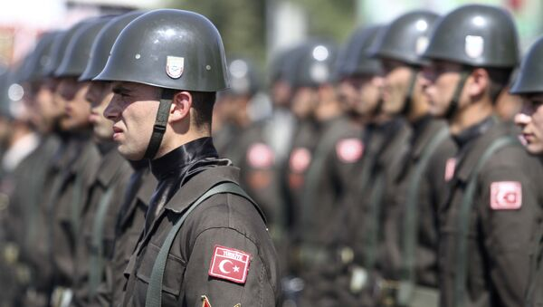 Turkish soldiers attend an army parade marking the 38th anniversary of the Turkish military invasion of Cyprus, on July 20, 2012 in Nicosia, in the northern Turkish-controlled area of the of the east Mediterranean island - Sputnik International
