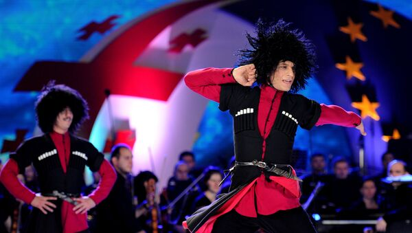 Georgia's dancers perform during celebrations for the signing of an association agreement with the EU in Tbilisi on June 27, 2014 - Sputnik International