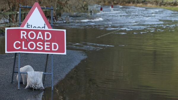 A road is closed due to flooding near the village of Pooley Bridge in North West England, December 10, 2015 - Sputnik International