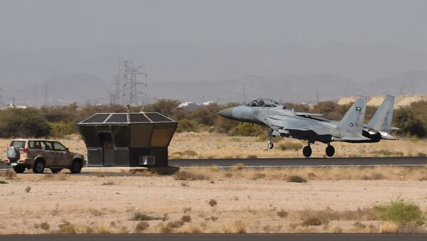 A picture taken on November 16, 2015 shows a Saudi F-15 fighter jet landing at the Khamis Mushayt military airbase, some 880 km from the capital Riyadh - Sputnik International