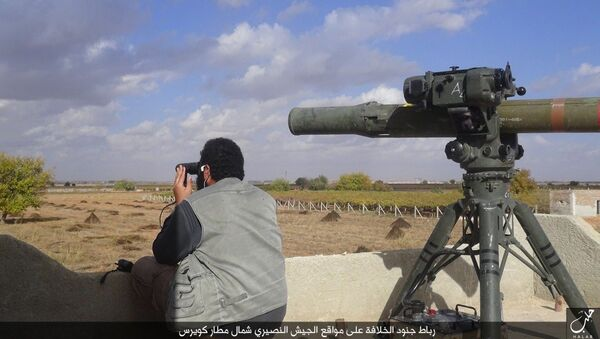 In this file photo released on Dec. 21, 2015, by the Rased News Network on a page affiliated with Islamic State militants, an Islamic State militant prepares to fire a TOW-1 anti-tank missile in Aleppo, northern Syria - Sputnik International