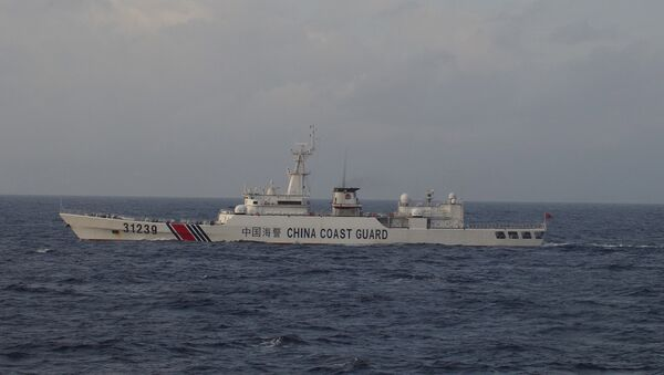 China Coast Guard vessel No. 31239 sails in the East China Sea near the disputed isles known as Senkaku isles in Japan and Diaoyu islands in China, in this handout photo taken and released by the 11th Regional Coast Guard Headquarters-Japan Coast Guard December 22, 2015 - Sputnik International