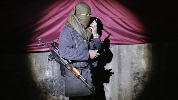 A militant of the Kurdistan Workers' Party, or PKK, stands at a barricade in Sirnak, Turkey, late Wednesday, Dec. 23, 2015. - Sputnik International