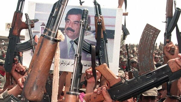 Iraqi soldiers hold up their arms during celebrations to mark the 61st birthday of Iraqi President Saddam Hussein 28 April 1998, in his home town of Tikrit, north of Baghdad - Sputnik International