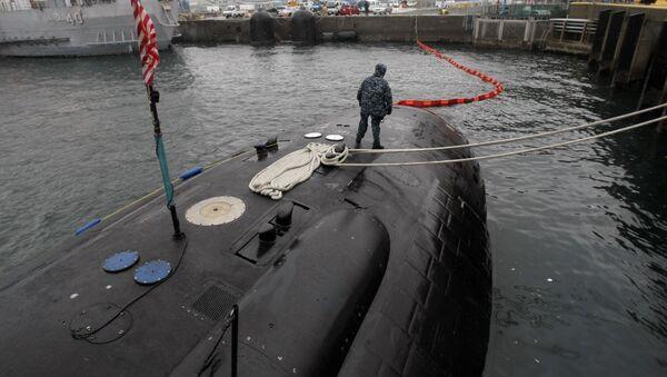 Crew member patrols on the USS Charlotte, a nuclear powered attack submarine, at the Yokosuka Naval Base, south of Tokyo. (File) - Sputnik International