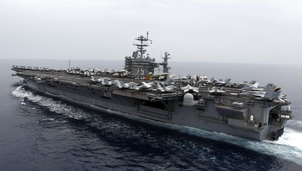 A general view shows the nuclear-powered aircraft carrier USS Harry S. Truman at an undisclosed position in the Mediterranean Sea, south of Sicily, Monday June 14, 2010 - Sputnik International