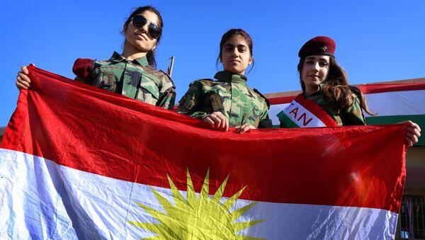 Iraqi Kurdish girls carry a Kurdistan flag during the celebration of Flag Day in the northern city of Arbil, the capital of the autonomous Kurdish region in northern Iraq - Sputnik International