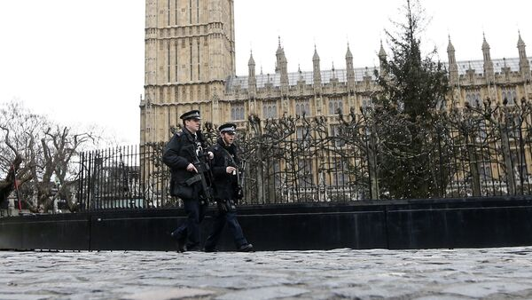 Armed police are seen on patrol at The Houses of Parliament in London, England - Sputnik International