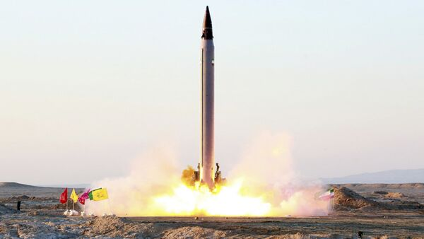 Launching of an Emad long-range ballistic surface-to-surface missile in an undisclosed location - Sputnik International