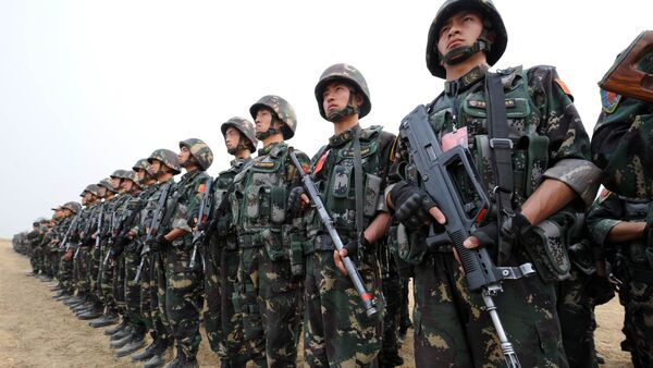In this photograph taken on November 24, 2011 Chinese People's Liberation Army (PLA) soldiers take part in the Pakistan-China anti-terrorist drill as they wrap up their two-week military exercise in Jhelum, 85 kilometres southeast of Islamabad - Sputnik International