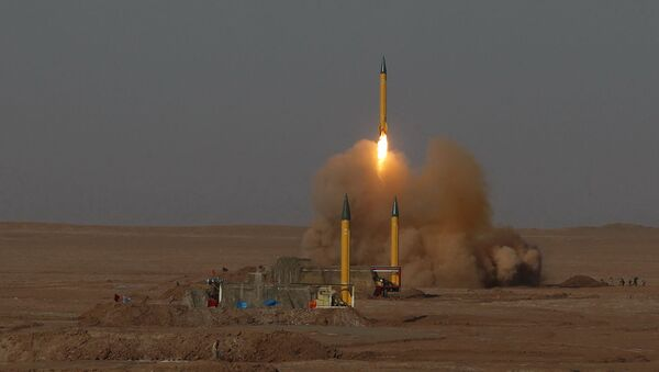 In this picture released by the Iranian Fars News Agency, asurface-to-surface missile is launched during the Iranian Revolutionary Guards maneuver in an undisclosed location in Iran, Tuesday, July 3, 2012 - Sputnik International