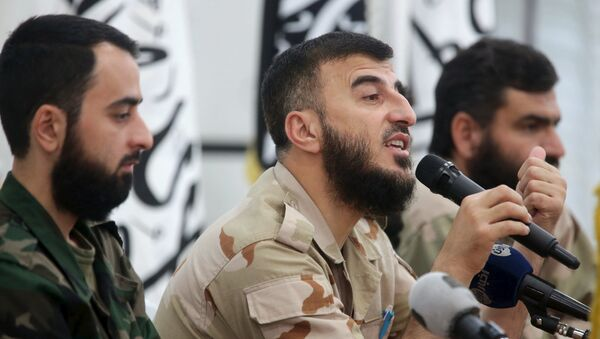 Zahran Alloush (C), commander of Jaysh al Islam, talks during a conference in the town of Douma, eastern Ghouta in Damascus, Syria August 27, 2014 - Sputnik International