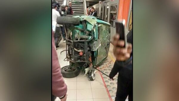 Cell phone shot of the remains of a car pushed down subway station cars by teenagers in Brussels. - Sputnik International