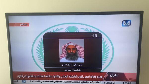 Saudi Arabia's state television channel displays an image of Sheikh Nimr al-Nimr, Saturday, Jan. 2, 2016, Dubai - Sputnik International