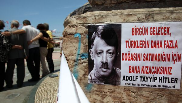 A depiction of Turkish Prime Minister Recep Tayyip Erdogan portraying him as Nazi leader Adolf Hitler is pasted on the front of Mustafa Kemal Ataturk's statue, founder of Turkey, at the Taksim square in Istanbul on Thursday, June 6, 2013 - Sputnik International