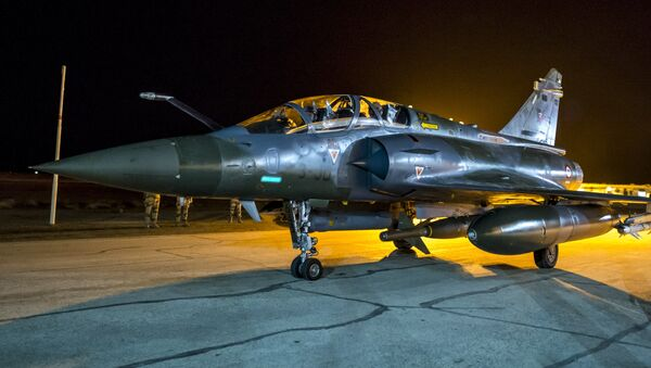 This photo released on Monday, Nov. 9, 2015 by the French Army Communications Audiovisual office (ECPAD) shows a French army Mirage 2000 jet on the tarmac of an undisclosed air base as part of France's Operation Chammal launched in September 2015 in support of the US-led coalition against Islamic State group - Sputnik International