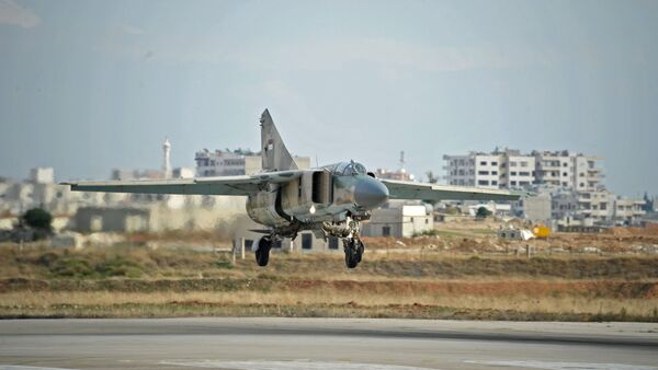 A MiG-23 aircraft of the Syrian Air Force lands at the Hama airbase near the city of Hama, Syria's Hama Province - Sputnik International