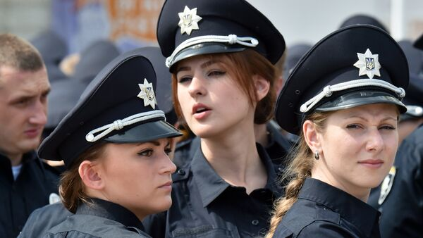 Police officers look on prior to an official ceremony in Kiev, on July 4, 2015 - Sputnik International