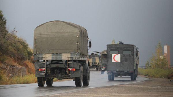 Algerian military trucks are pictured in the Tizi Ouzou region, northern Algeria, on Wednesday, Sept. 23, 2014 - Sputnik International