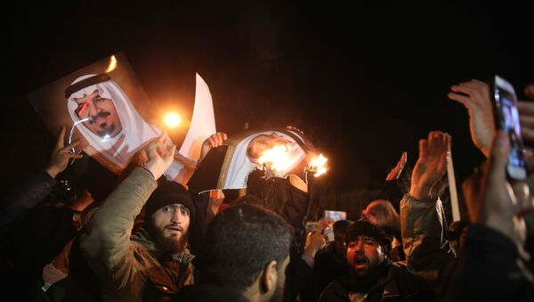 Iranian protesters gather outside the Saudi Embassy in Tehran during a demonstration against the execution of prominent Shiite Muslim cleric Nimr al-Nimr by Saudi authorities, on January 2, 2016 - Sputnik International