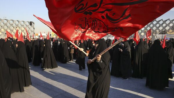 Iranian women wave flags that read, Death to America and we shall never accept humiliation, during a rally to protest the execution by Saudi Arabia last week of Sheikh Nimr al-Nimr, a prominent opposition Saudi Shiite cleric, in Tehran, Iran, Monday, Jan. 4, 2016 - Sputnik International