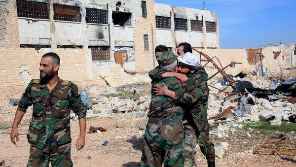 Syrian government troops hug each other in celebration inside the Kuweires air base, east of Aleppo, Syria - Sputnik International