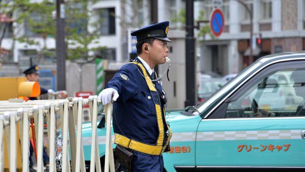 Police officer  in Tokyo - Sputnik International