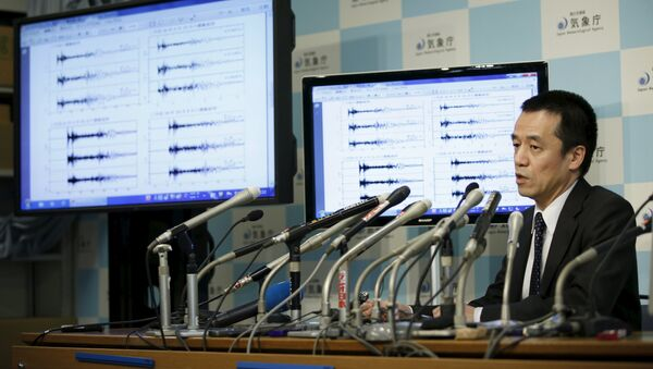 Japan Meteorological Agency's earthquake and tsunami observations division director Yohei Hasegawa speaks next to graphs of ground motion waveform data observed in Japan during a news conference at the Japan Meteorological Agency in Tokyo on implications that an earthquake sourced around North Korea was triggered by an unnatural reason January 6, 2016 - Sputnik International
