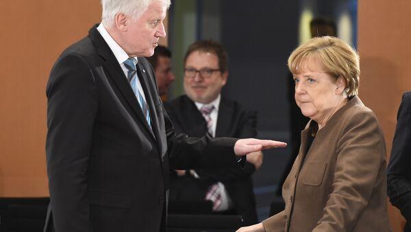 Bavarian Premier Horst Seehofer has called on German Chancellor Angela Merkel to introduce a series of security crackdowns following recent attacks. - Sputnik International