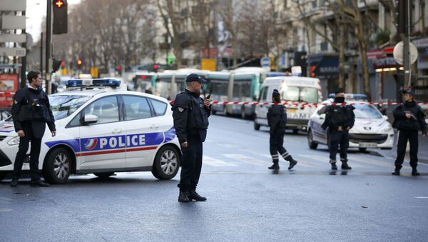 French police secure the area after a man was shot dead at a police station in the 18th district in Paris, France January 7, 2016 - Sputnik International
