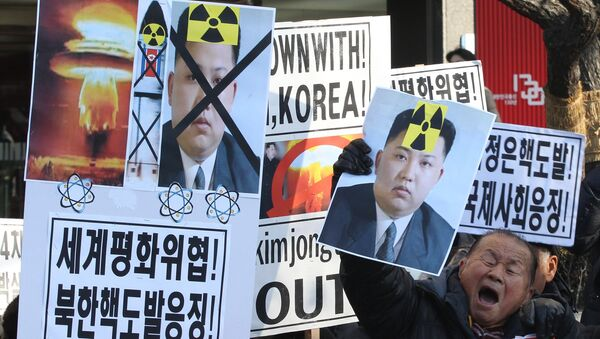 A South Korean protester with a photo of North Korean leader Kim Jong Un shouts slogans during a rally against North Korea's announcement that it had tested a hydrogen bomb. - Sputnik International