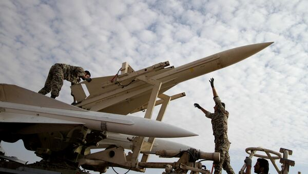 Iranian soldiers prepare to launch a Hawk surface-to-air missile during military maneuvers at an undisclosed location - Sputnik International