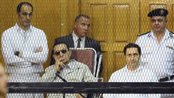 FILE - In this Sept. 14, 2013 file photo, former Egyptian President Hosni Mubarak, seated center left, and his two sons, Gamal Mubarak, left, and Alaa Mubarak attend a hearing in a courtroom in Cairo, Egypt - Sputnik International