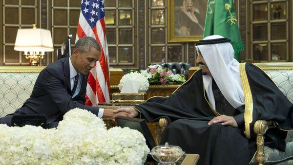 President Barack Obama and new Saudi Arabian King, Salman bin Abdul Aziz, are photographed as they shake hands in a bilateral meeting at Erga Palace in Riyadh, Saudi Arabia, Tuesday, Jan. 27, 2015 - Sputnik International