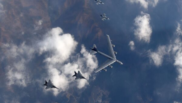 This picture taken by the Republic of Korea Air Force on January 10, 2016 and released via Yonhap news agency shows a US B-52 Stratofortress (C) flying with South Korean F-15K fighter jets (bottom) and US F-16 fighter jets (top) over South Korea - Sputnik International
