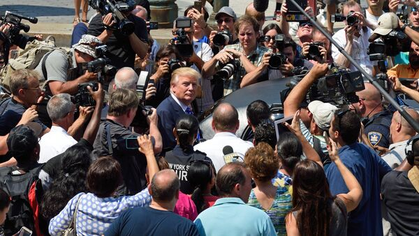 US presidential candidate Donald Trump(C) is mobbed by the media as he exits New York Supreme Court after morning jury duty August 17, 2015 in New York - Sputnik International