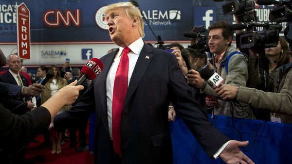 Republican presidential candidate businessman Donald Trump speaks with the media in the Spin Room following the Republican Presidential Debate, hosted by CNN, at The Venetian Las Vegas on December 15, 2015 in Las Vegas, Nevada - Sputnik International