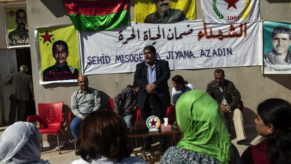 Salih Muslim, head of the Democratic Union Party (PYD) receives condolences from Kurdish people after his son Servan was killed allegedly by a Jabhat al-Nusra sniper several days ago on October 15, 2013. - Sputnik International